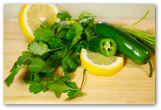 fresh cilantro, lemon slices and peppers