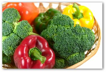 fresh broccoli and bell peppers in a bowl