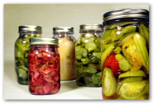 various canned vegetables in glass jars
