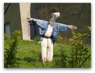 garden scarecrow with bowler-hat