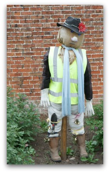 scarecrow dressed as gardener