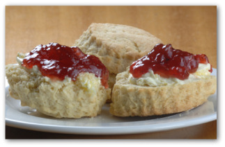 scones with strawberry jam on them