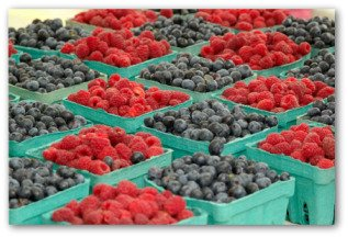containers of raspberries and blueberries