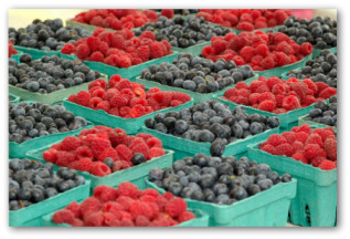 fresh blueberries and raspberries in containers