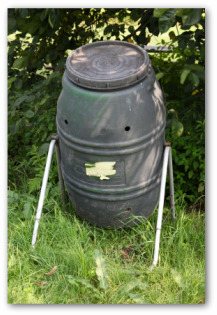 compost bin tumbler in a backyard
